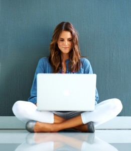 Confident woman with laptop
